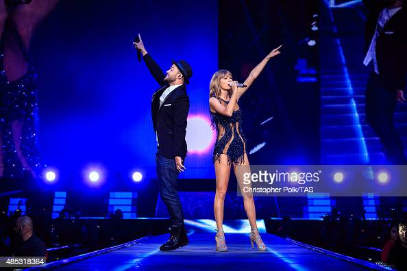 Singersongwriters Justin Timberlake and Taylor Swift perform onstage during Taylor Swift The 1989 World Tour Live In Los Angeles at Staples Center on...
