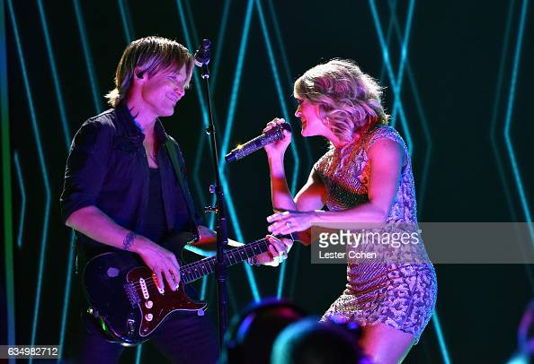 Singersongwriters Keith Urban and Carrie Underwood perform onstage during The 59th GRAMMY Awards at STAPLES Center on February 12 2017 in Los Angeles...