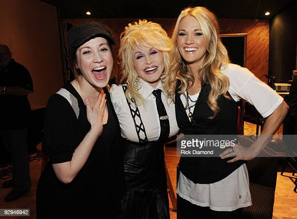 Singer/songwriters Kellie Pickler Dolly Parton and Carrie Underwood backstage at Parton's 'Live From London' DVD premiere party at the Tracking Room...