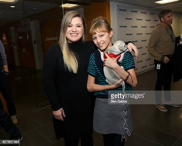 Singersongwriters Kelly Clarkson and Grace VanderWaal with her dog Frankie at SiriusXM Studio on December 5 2016 in New York City