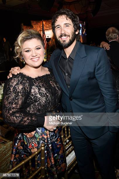 Singer/songwriters Kelly Clarkson and Josh Groban attend Muhammad Ali's Celebrity Fight Night XXI at the JW Marriott Phoenix Desert Ridge Resort Spa...