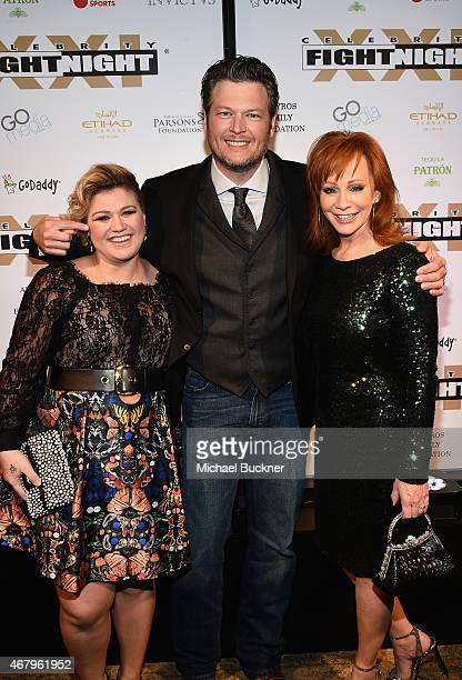 Singer/songwriters Kelly Clarkson Blake Shelton and Reba McEntire attend Muhammad Ali's Celebrity Fight Night XXI at the JW Marriott Phoenix Desert...