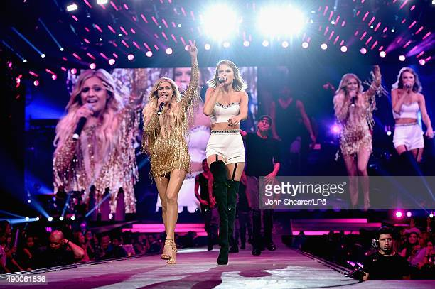 Singer/songwriters Kelsea Ballerini and Taylor Swift perform onstage during The 1989 World Tour live in Nashville at Bridgestone Arena on September...