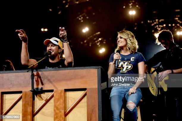 Singersongwriters Luke Bryan and Carrie Underwood perform on stage and Kick off the 'Huntin' Fishin' And Lovin' Every Day' Tour at Bridgestone Arena...