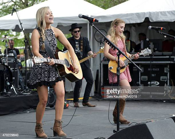 Singer/songwriters Madison Marlow and Taylor Dye of Maddie Tae perform during the ACM Party For A Cause Festival at Globe Life Park in Arlington on...