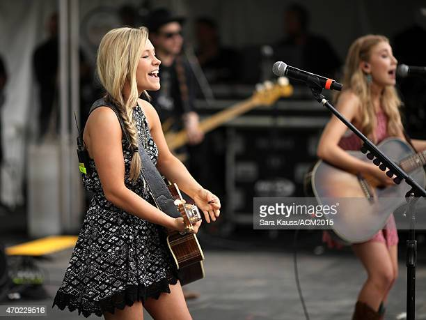 Singer/songwriters Madison Marlow and Taylor Dye of Maddie Tae pose backstage during the ACM Party For A Cause Festival at Globe Life Park in...