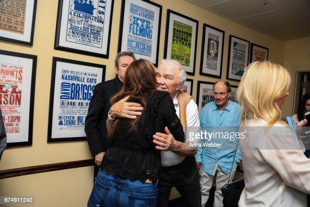 Singer/Songwriters Matraca Berg and Dickey Lee hug backstage during Jimmy Webb Poets And Prophets Session at Country Music Hall of Fame and Museum on...