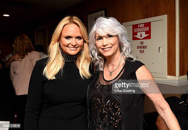 Singersongwriters Miranda Lambert and Emmylou Harris backstage during the 10th Annual ACM Honors at the Ryman Auditorium on August 30 2016 in...