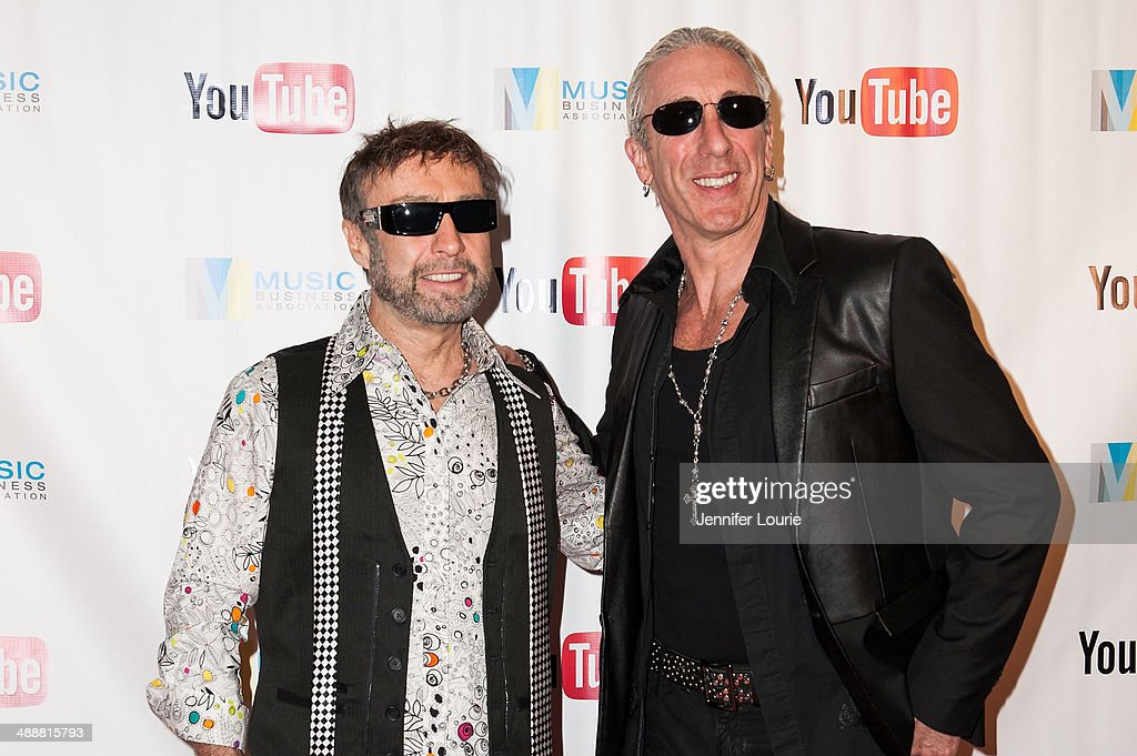 Singer-songwriters Paul Rodgers and Dee Snider receive an award at the Music Biz 2014 Awards at the Hyatt Regency Century Plaza on May 8, 2014 in Century City, California.