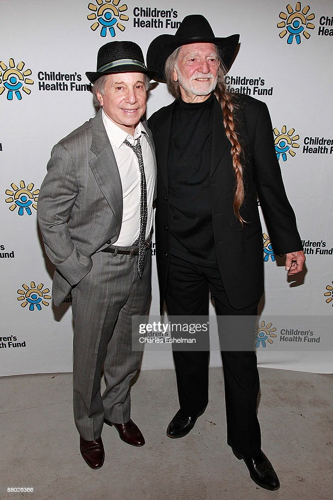 Singer/songwriters Paul Simon and Willie Nelson attend the 2009 Children's Health Fund benefit at the Sheraton New York Hotel & Towers on May 27, 2009 in New York City.