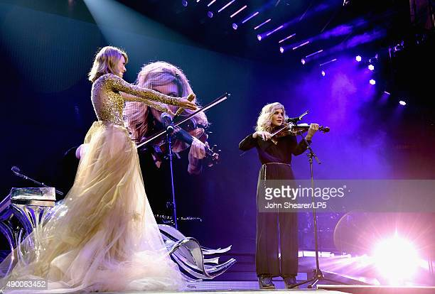 Singer/songwriters Taylor Swift and Alison Krauss perform onstage during The 1989 World Tour live in Nashville at Bridgestone Arena on September 25...