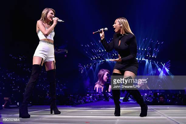 Singer/songwriters Taylor Swift and Leona Lewis perform onstage during The 1989 World Tour live in Nashville at Bridgestone Arena at Bridgestone...