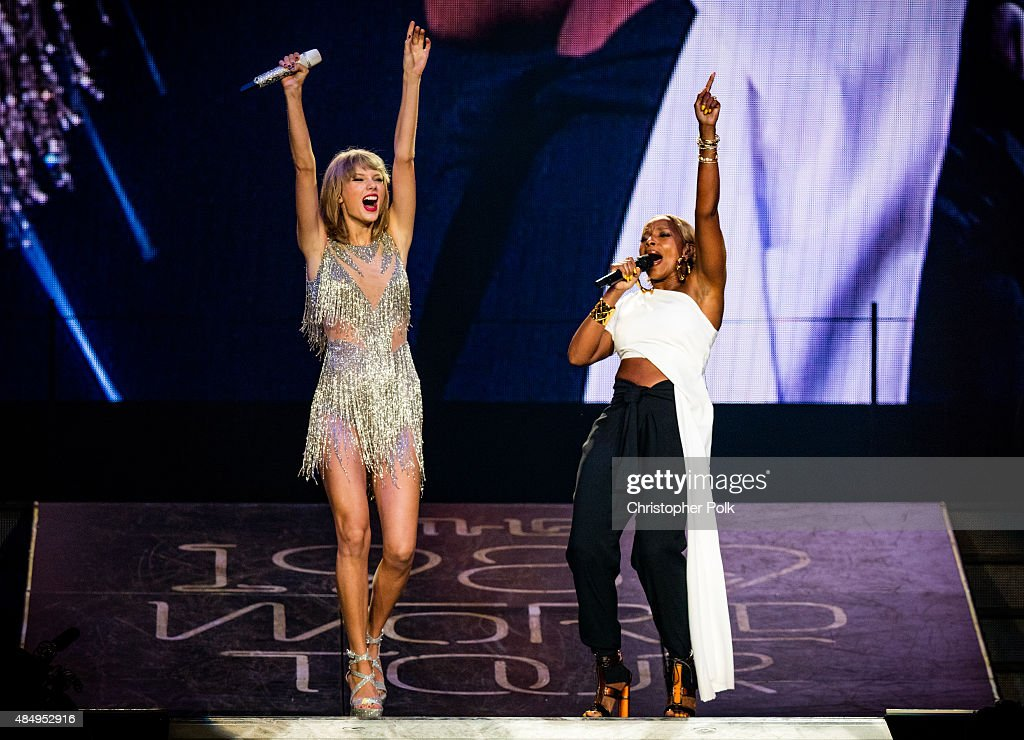 Singer-songwriters Taylor Swift (L) and Mary J. Blige perform onstage during Taylor Swift The 1989 World Tour Live In Los Angeles at Staples Center on August 22, 2015 in Los Angeles, California.