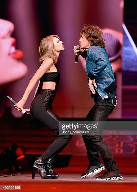 Singer/songwriters Taylor Swift and Mick Jagger perform onstage during The 1989 World Tour live in Nashville at Bridgestone Arena at Bridgestone...