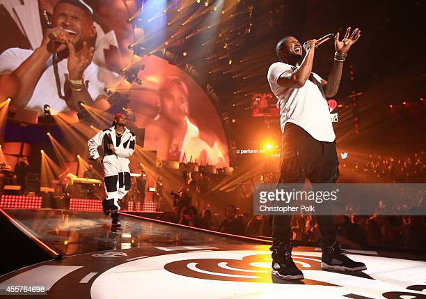 Singer/songwriters Usher and Chris Brown perform onstage during the 2014 iHeartRadio Music Festival at the MGM Grand Garden Arena on September 19...