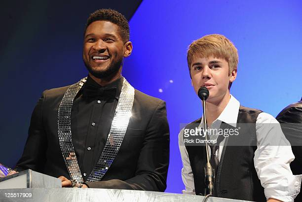 Singer/Songwriters Usher Raymond and Singer/Songwriter Justin Bieber present to 2011 inducee Jan Smith at the 33rd Annual Georgia Music Hall Of Fame...