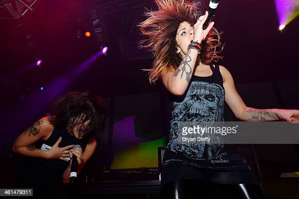 Singer/songwriters Yasmine Yousaf and Jahan Yousaf of Krewella perform onstage at a private party celebrating CES 2014 hosted by iHeartRadio...