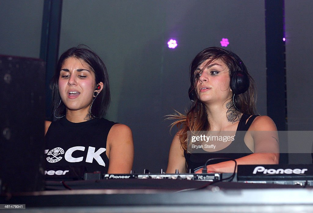 Singer/songwriters Yasmine Yousaf (L) and Jahan Yousaf of Krewella perform onstage at a private party celebrating CES 2014 hosted by iHeartRadio featuring a live performance by Krewella at Haze Nightclub at the Aria Resort & Casino at CityCenter on January 8, 2014 in Las Vegas, Nevada.