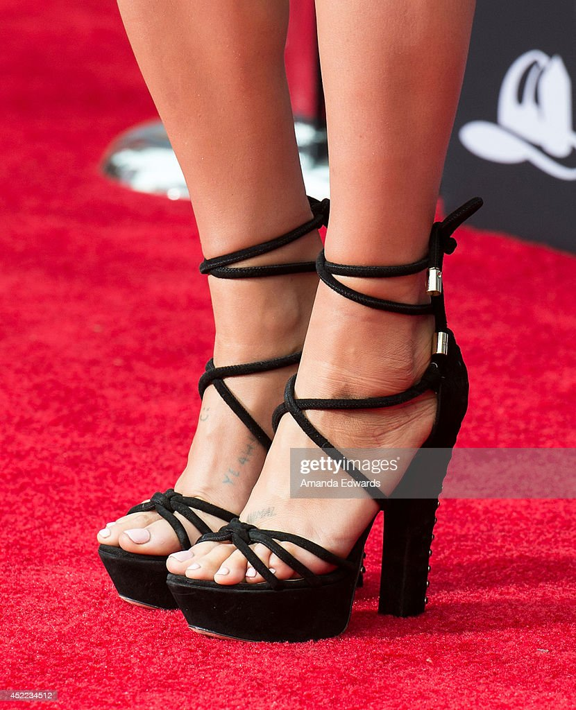 Singer-sonwriter Kesha (shoe detail) arrives at the Los Angeles premiere of Disney's 'Planes: Fire & Rescue' at the El Capitan Theatre on July 15, 2014 in Hollywood, California.
