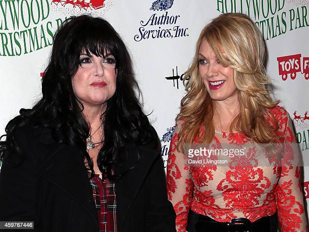 Singers/sisters Ann Wilson and Nancy Wilson of Heart attend the 83rd Annual Hollywood Christmas Parade on November 30 2014 in Hollywood California