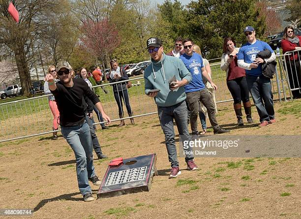 Singers/Songwriters Brad Cummings Chris Lucas compete during the 3rd Annual Craig Campbell Celebrity Cornhole Challenge to Fight Colorectal Cancer at...