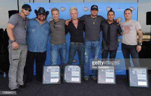 Singers/Songwriters Brantley Gilbert Colt Ford Jason Aldean with Jason Aldean's band during the BMI Party honoring 'Dirt Road Anthem' Performed By...