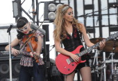Singers/Songwriters Eric The JaneDear Girls Susie Brown and Danelle Leverette perform during Country Thunder Arizona Day 2 on April 8 2011 in...