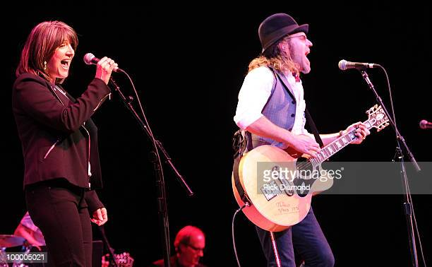 Singers/Songwriters Kathy Mattea and Big Kenny Alphin perform during the 'Music Saves Mountains' benefit concert at the Ryman Auditorium on May 19...