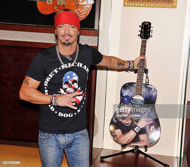 Singer/TV personality Bret Michaels poses for a photo with the guitar he donated to Hard Rock Cafe at Hard Rock Cafe New York on July 18 2014 in New...