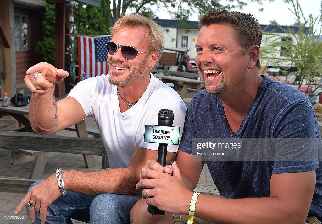 Singe/Songwriter <a gi-track='captionPersonalityLinkClicked' href=/galleries/search?phrase=Phil+Vassar&family=editorial&specificpeople=619225 ng-click='$event.stopPropagation()'>Phil Vassar</a> visits Storme Warren at GAC Headline Country during Country Thunder - Twin Lakes, Wisconsin - Day 3 on July 20, 2013 in Twin Lakes, Wisconsin.