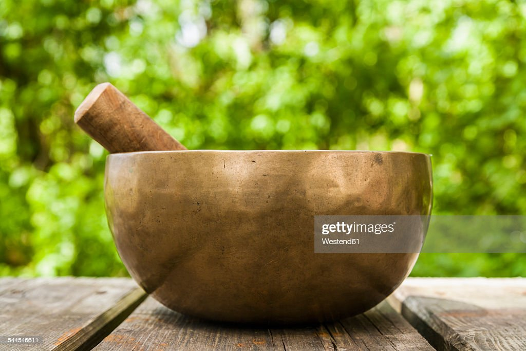 Singing bowl on wooden terrace