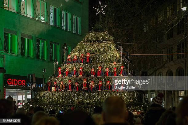 Singing christmas tree during christmas time Werdmühleplatz Zürich Switzerland