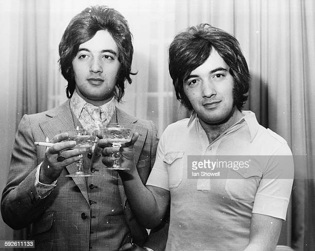 Singing duo and twins Paul and Barry Ryan sharing a toast as they celebrate their new million dollar contract with Polydor at the Britannia Hotel...