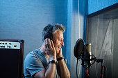 Professional singer practicing song recording in audio studio