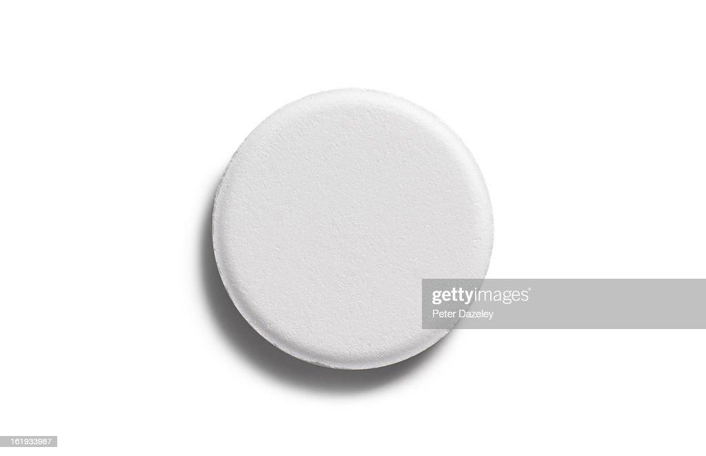 Single aspirin pill close up