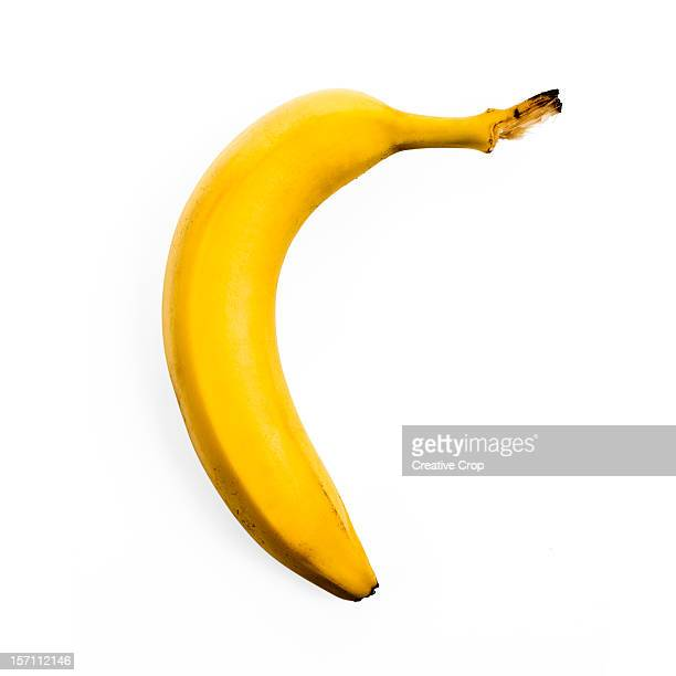 Single banana still in skin