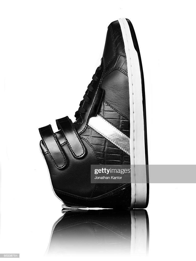 Single Black Sneaker : Stock Photo