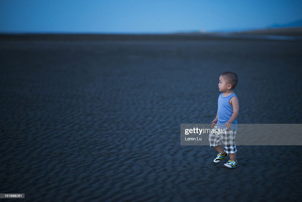 Single boy lost in wild in the evening : Stock Photo