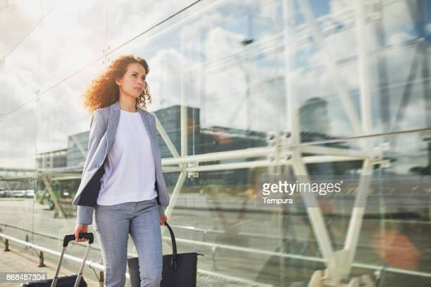 Single business woman commuting, on the move.