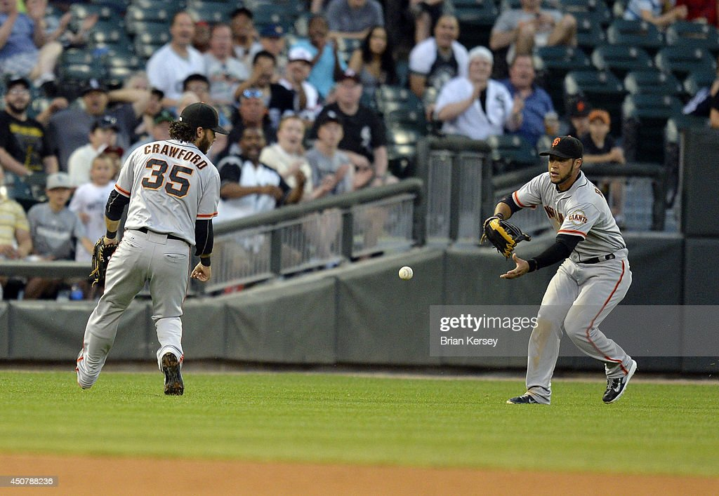 A single by Alexei Ramirez #10 of the Chicago White Sox falls in between shortstop <a gi-track='captionPersonalityLinkClicked' href=/galleries/search?phrase=Brandon+Crawford&family=editorial&specificpeople=5580312 ng-click='$event.stopPropagation()'>Brandon Crawford</a> #35 and left fielder <a gi-track='captionPersonalityLinkClicked' href=/galleries/search?phrase=Gregor+Blanco&family=editorial&specificpeople=4137600 ng-click='$event.stopPropagation()'>Gregor Blanco</a> #7 of the San Francisco Giants during the fourth inning at U.S. Cellular Field on June 17, 2014 in Chicago, Illinois.