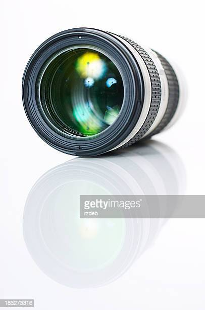 A single camera photo lens reflecting on the surface