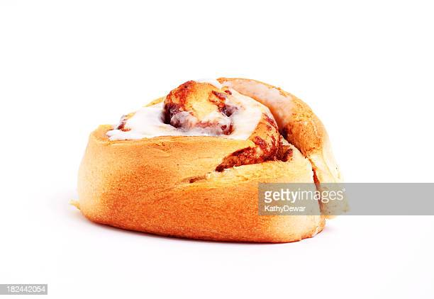 Single Cinnamon Bun with Icing on a white Background