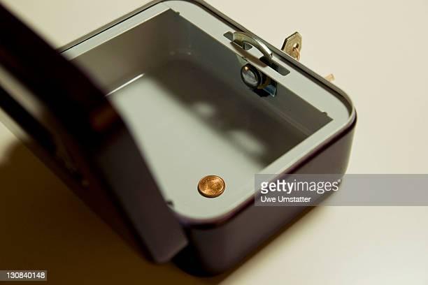 Single coin in a cash box