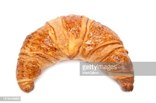 A single croissant against a white background