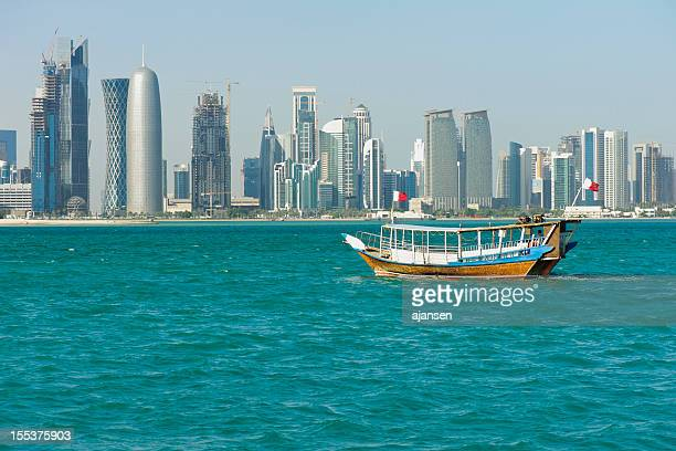Single dhow on the waters near the harbor of Doha, Qatar