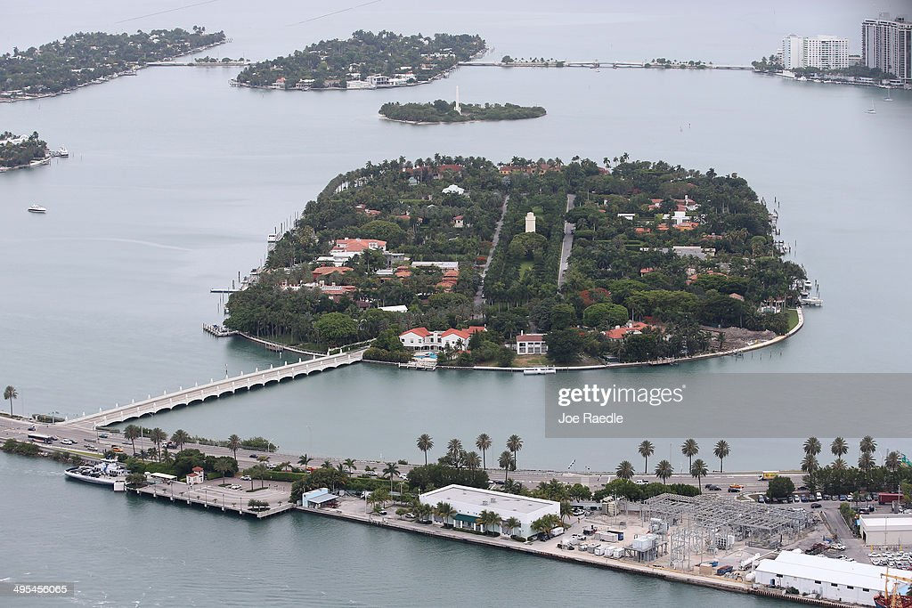 Single family homes are seen on Star Island and the Venetian Islands are seen June 3, 2014 in Miami, Florida. According to numerous scientists, south Florida could be flooded by the end of the century as global warming continues to melt the Arctic ice, in turn causing oceans to rise. U.S. President Barack Obama and the Environmental Protection Agency yesterday announced a rule that would reduce the nation's biggest source of pollution, carbon emissions from power plants, 30% by 2030 compared to 2005 levels. It is widely believed that these emissions are a main cause of global warming.