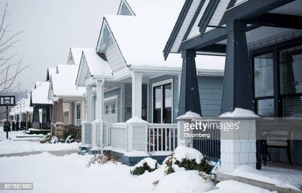Single family homes stand at the Tsawwassen Shores residential development in Tsawwassen British Columbia Canada on Wednesday Feb 8 2017 The new...