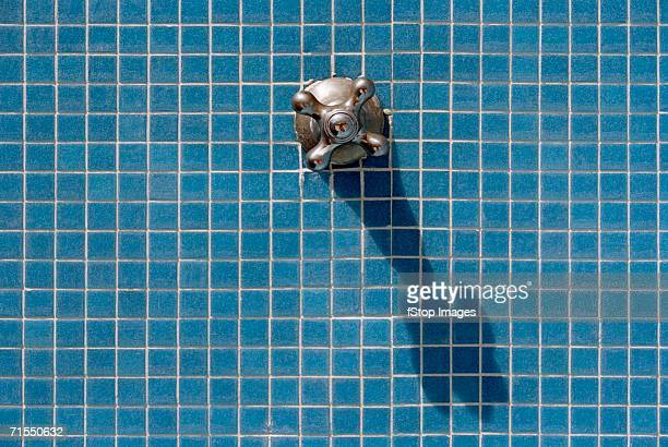 Single faucet on blue tiles