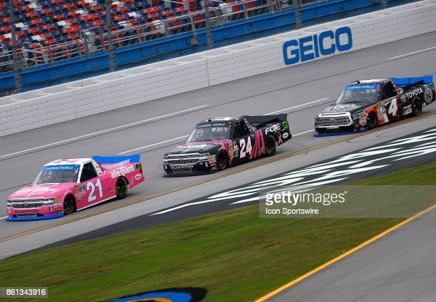 Single file racing at the front of the pack during the Fred's 250 NASCAR Camping World truck race on October 14 at the Talladega Superspeedway in...