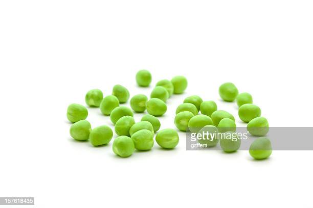 Single fresh green peas isolated on a white background